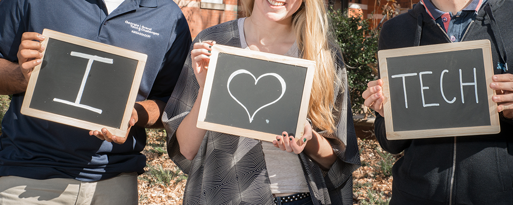 A picture of three chalkboards that say I heart Tech!