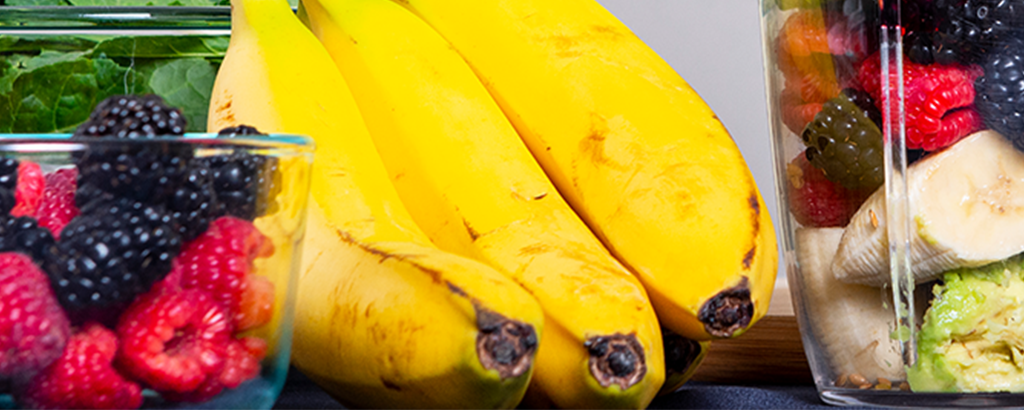A picture of berries and bananas.